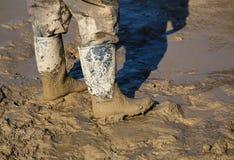 Stivali fangosi del lavoro Fotografia Stock Libera da Diritti