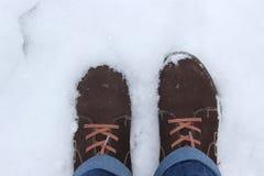 Stivali nella neve Fotografia Stock