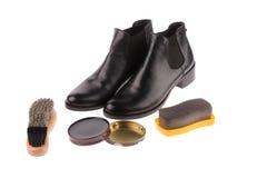 Stivali neri con la spazzola della scarpa Fotografia Stock Libera da Diritti
