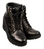 Stivali neri della caviglia delle signore Fotografie Stock