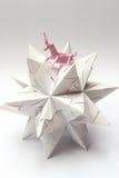 Stjärna för papper för origamienhörningridning Arkivbilder