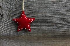 Stjärna för tyg för garnering för glad jul röd Fotografering för Bildbyråer
