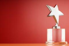 stjärna för utmärkelsebakgrundslutning Arkivbild