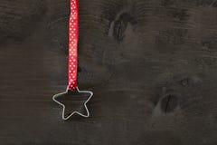 Stjärna formad kakaskärare Royaltyfri Foto