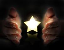 Stjärna i hand Arkivbild