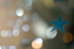 Stjärna med suddig bakgrund Arkivfoto