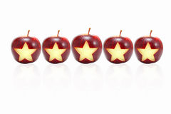 Stjärna på äpplet Arkivfoto