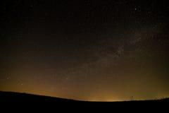 Stjärnklar himmel för natt för bakgrund Royaltyfria Bilder