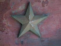 Stjärnan belägger med metall bakgrund fotografering för bildbyråer