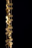 stjärnor för guld för julgarneringgirlander fotografering för bildbyråer