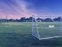 Stjärnor för himmel för fotboll för sportfält arkivbild