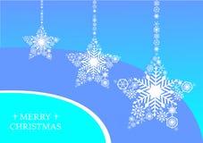 Stjärnor för vit jul med snöflingor på en blå bakgrund Arkivbild