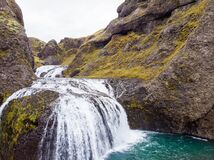 View from flying drone of Stjornarfoss waterfall. Impressive summer sunrise in Iceland, Europe. Beauty of nature concept
