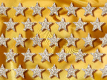 stjärnor för bakgrundsguldjewelery Arkivbild