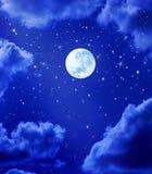 stjärnor för moonnattsky Arkivfoton