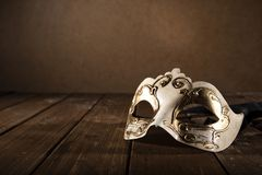 Stll life of a carnival mask on a wood floor. Stll life of a vintage carnival mask on a wood floor royalty free stock photography