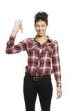 Stämm den hållande uppsättningen för den unga kvinnan av huset Arkivbilder