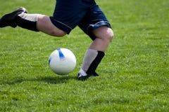 Stoß-Fußball-Kugel stockfoto