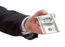 Sto dolarów banknotu w męskiej ręce Fotografia Stock