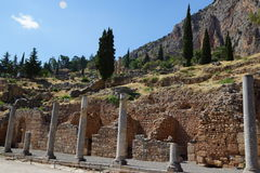 The Stoa of the Athenians, Delphi, Greece. The Stoa of the Athenians built in Delphi, Greece, in 478 BC, was part of the building program of Perikles and royalty free stock photo