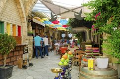 Stoa Fylaktou, Limassol, Cyprus. Stoa Fylaktou in the historic medieval city center of Limassol in Cyprus. A view of the cafe, restaurant, the colorful umbrellas Royalty Free Stock Photo