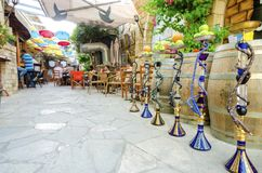 Stoa Fylaktou, Limassol, Cyprus. Stoa Fylaktou in the historic medieval city center of Limassol in Cyprus. A view of the cafe, restaurant, the colorful umbrellas Stock Photos