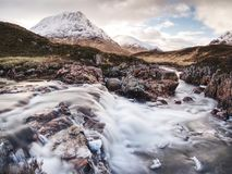 The Stob Dearg peak of Buachaille Etive Mor at the entrance to Glen Coe. Scottish highlands in early spring Stock Photography