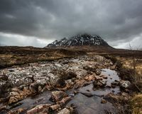 Buachaille Etive Mor in the clouds. Stob Dearg and the River Coupall, at Buachaille Etive Mor, Glencoe in the Scottish Highlands Stock Photos