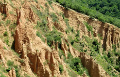 Stobskie piramidy or Stob's Pyramids unusual shaped red and yellow rock formation Stock Photos