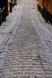 Stoccolma, Svezia, strada antica del ciottolo Immagine Stock