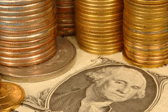 Stock. Gold and silver coins and the portrait of Washington from a dollar banknote Royalty Free Stock Images