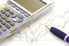 Stock. Chart, calculator and blue pen royalty free stock photo