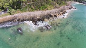 Stock aerial picture image of Lone Surfer Noosa. Stock aerial photograph picture image of lone surfer at Noosa National Park .Featuring surf break and clear Stock Photos