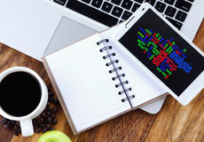 Stock Analysis word cloud arrangement concept on smartphone. Notebook,smartphone, book and a cup of coffee on wooden table stock photos