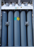 Stock of blue cylinders Stock Image