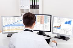 Stock broker trading in a bull market Stock Photo