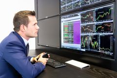 Stock broker trading online, talking on mobile phone. royalty free stock photo
