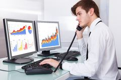 Stock broker working at office Royalty Free Stock Image