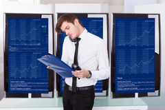 Stock Broker Working At Office Royalty Free Stock Photo