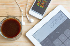 Stock calculator and coffee concept Stock Photos