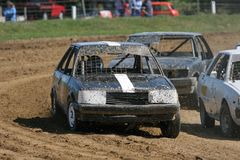 Stock car racing. Saloon stock cars racing on a flat dirt track. At a small speedway track in New Zealand stock photography
