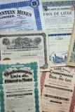 Stock Certificates. Collection of stock (share) certificates of mining companies. Most of them issued in Belgium at the beginning of the 20th century stock photography