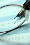Stock chart. Fountain pen and glasses on stock chart Royalty Free Stock Photos