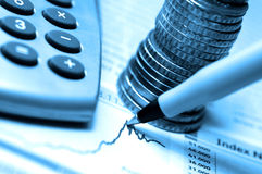 Stock chart. Pen, coins and calculator on stock chart Royalty Free Stock Photography