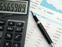 Stock chart. Good financial caculate on the financial sheet Stock Photo