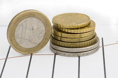 Stock chart and coin. Still life stock photography