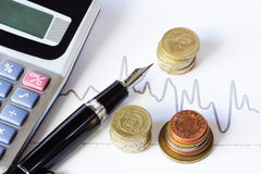 Stock chart and coins Royalty Free Stock Photography