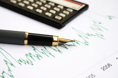 Stock chart and fountain pen Royalty Free Stock Images