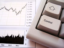 Stock chart and keyboard. Control key in foreground Stock Photos