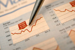 Stock chart and newspaper Stock Image